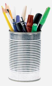 An old tin can as a desk tidy for pens and pencils
